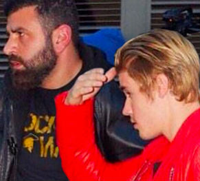 Justin Bieber with bodyguard